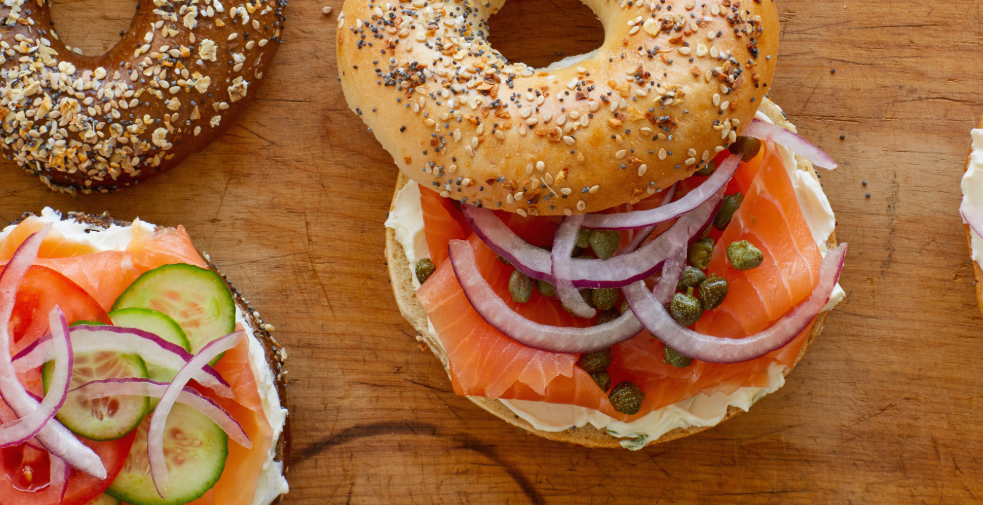 bagels with lox, cream cheese and onion